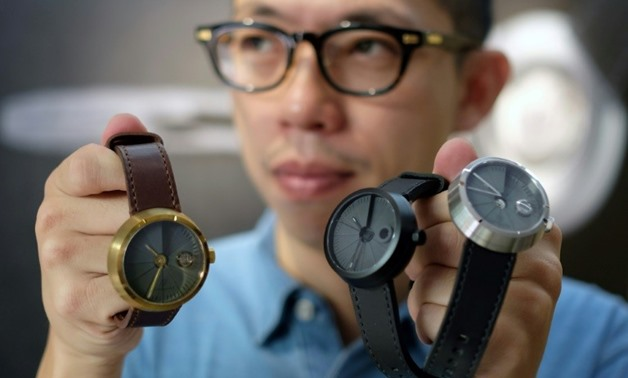 Jewellery and watchmaker Sean Yu creates watches made with a cement surface that are a huge hit with Taiwan's consumers - AFP / SAM YEH