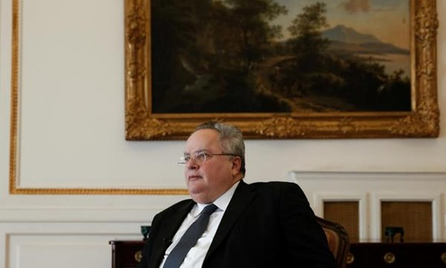 FILE PHOTO - Greek Foreign Minister Nikos Kotzias speaks during an interview with Reuters at the Foreign Ministry in Athens, Greece, January 31, 2018.