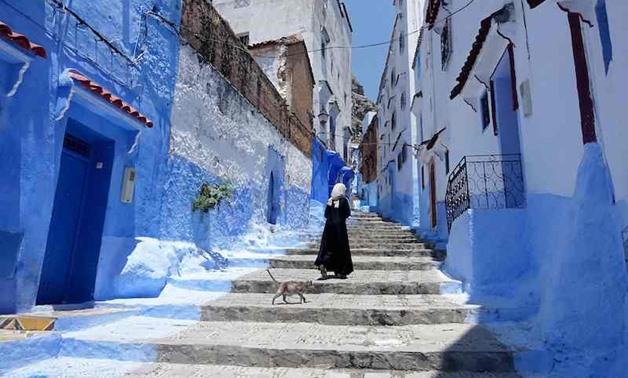 Huddling against a hillside in northern Morocco is Chefchaouen, a tourist town famed for the striking blue of its buildings - AFP