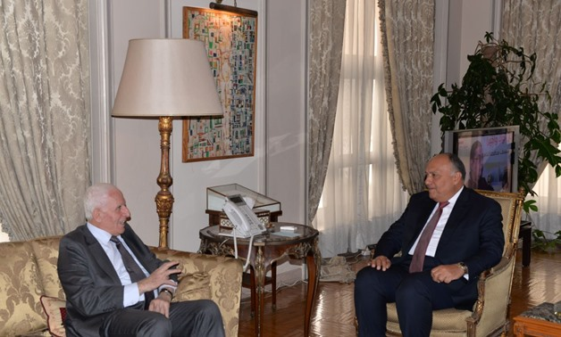 Egypt's Foreign Affairs Minister Sameh Shoukry (R) and Fatah Leader Azzam Al-Ahmad (L) in Cairo on Feb 11, 2018- Press Photo