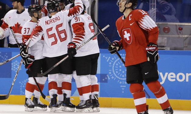 Ice Hockey – Pyeongchang 2018 Winter Olympics – Men Preliminary Round Match - Switzerland v Canada - Kwandong Hockey Centre, Gangneung, South Korea – February 15, 2018 - Raphael Diaz (R) of Switzerland reacts as Team Canada celebrates a goal. REUTERS/Davi