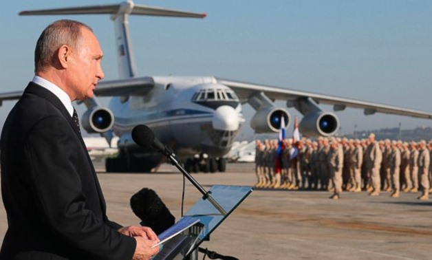 FILE - In this file photo taken on Tuesday, Dec. 12, 2017, Russian President Vladimir Putin addresses the troops at the Hemeimeem air base in Syria. Several private Russian military contractors were killed by a U.S. strike in Syria, Russian media reported