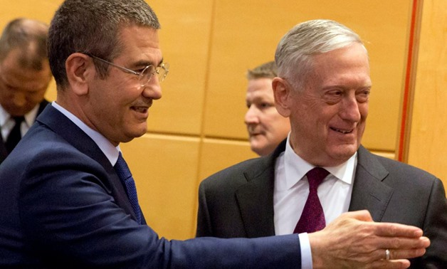 U.S. Secretary of Defence Jim Mattis poses with Turkish Defence Minister Nurettin Canikli during a NATO defence ministers meeting at the Alliance headquarters in Brussels, Belgium, February 14, 2018. REUTERS/Virginia Mayo/Pool