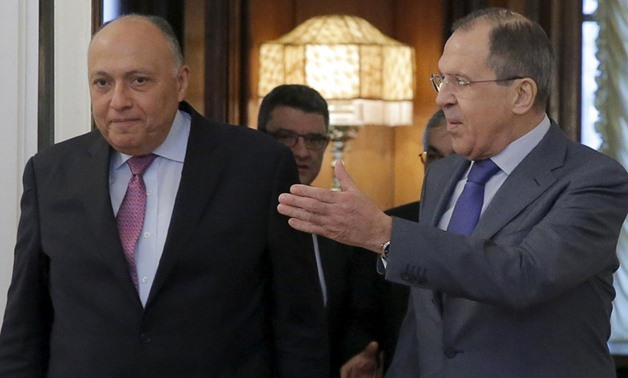 Russian Foreign Minister Sergei Lavrov (R) shows the way to his Egyptian counterpart Sameh Shukri during a meeting in Moscow, Russia, March 16, 2016. (Reuters)