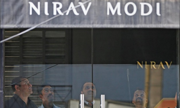 Security guards stand inside a Nirav Modi showroom during a raid by the Enforcement Directorate, a government agency that fights financial crime, in New Delhi, India, February 15, 2018. REUTERS/Adnan Abidi