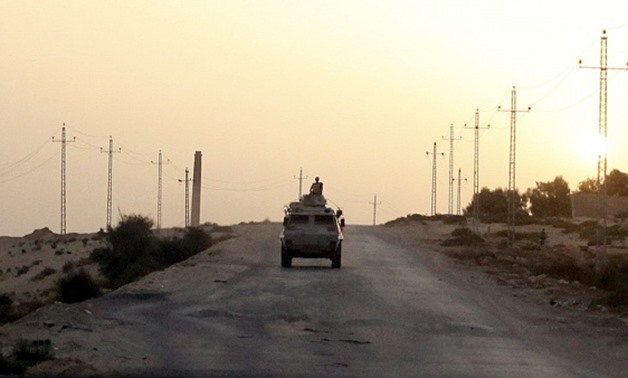 A military vehicle drives through northern Sinai. (Asmaa Waguih/Reuters)