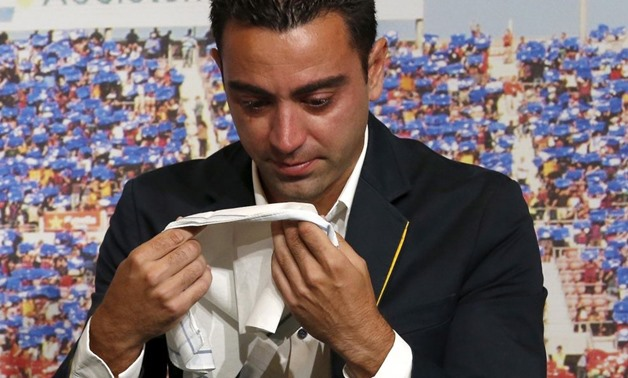 Barcelona's Xavi Hernandez cries during his farewell event at Auditori 1899 in Nou Camp stadium in Barcelona, Spain, June 3, 2015 - REUTERS/Gustau Nacarino