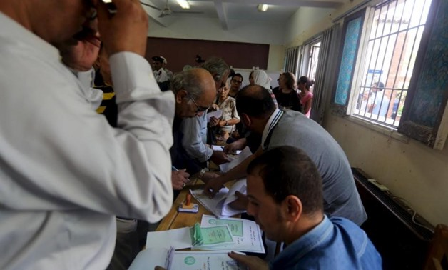 Egyptians cast their votes during parliamentary elections at a voting center in Giza governorate, Egypt, October 18, 2015. REUTERS/Mohamed Abd El Ghany