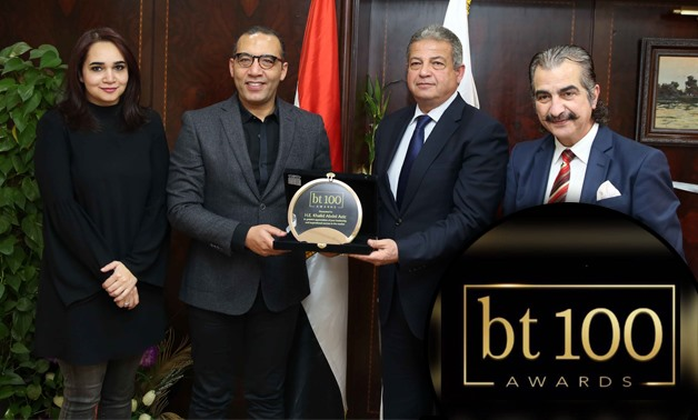 Minister of Youth and Sports Khaled Abdel Aziz receiving BT100's shield of honor by BT head of the editorial board Khaled Salah – Egypt Today/Hossam Atef