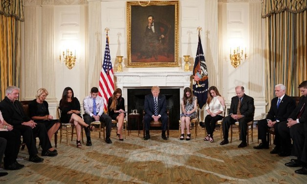 US President Donald Trump (C), who met with survivors of a mass shooting at a Florida high school, is pushing the idea of arming teachers to keep schools safe - AFP