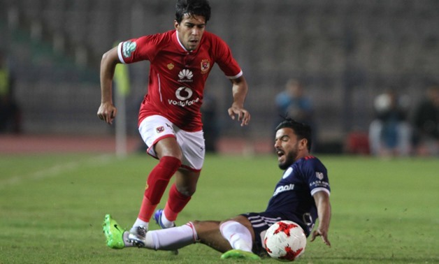 Soccer, Egyptian League, Feb, 19, 2018, Al Ahly's Ahmed Hamoudi dribbles Al Nasr defender during the first half - Egypt Today, Hassan Mohamed