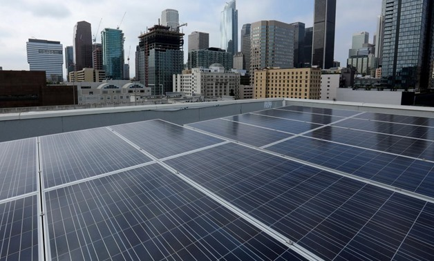 Solar electric panels are shown installed on the roof of the Hanover Olympic building, the first building to offer individual solar-powered net-zero apartments in Los Angeles, California, U.S., June 6, 2017 - REUTERS/Mike Blake/File Photo
