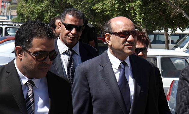 FILE: Former head of the Central Auditing Organization Hesham Geneina (R)