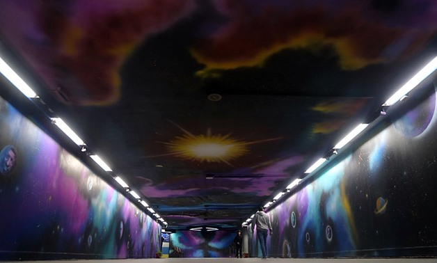 "A group of 11 young artists that goes by the name of ""Mobde'oon"" (Innovators), color Cairo's Opera metro station walls to represent the solar system - Mohamed al-Hosary"