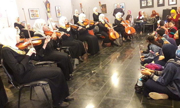 "Orchestra Al Nour Wal Amal performing at ""Music: Hope & Life"" as audiences with different abilities watch"