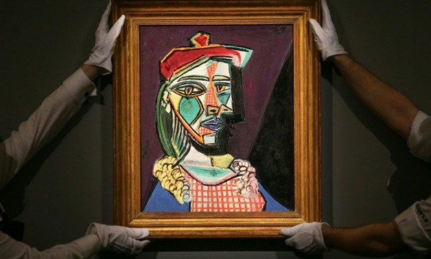 A Pablo Picasso portrait of his muse Marie-Therese Walter with future lover Dora Maar emerging from the shadows fetched £50 million (57 million euros, $69 million) at a London sale Wednesday, a European auction record for a painting
