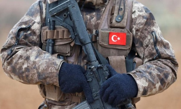 File photo: showing a member of Turkish police special forces standing guard in syria, Jan 24, 2018.  - REUTERS