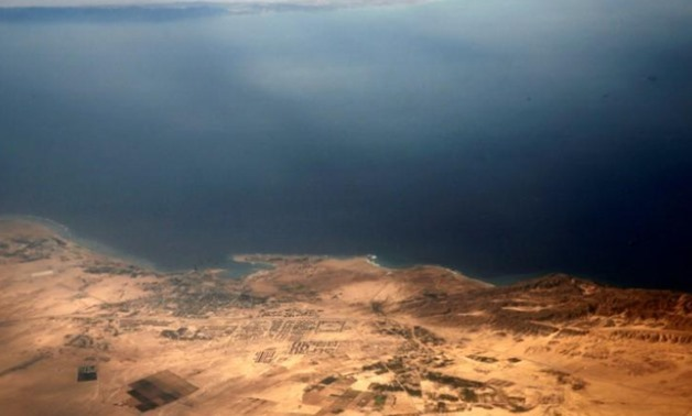 An aerial view of the coast of the Red Sea and the two islands of Tiran and Sanafir is pictured through the window of an airplane near Sharm el-Sheikh, Egypt November 1, 2016. Picture taken November 1, 2016. REUTERS/Amr Abdallah Dalsh