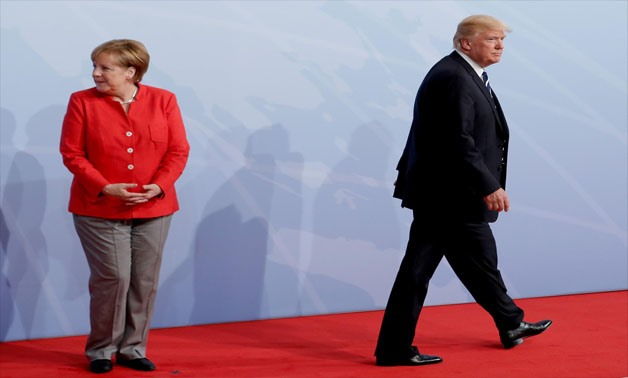 German Chancellor Angela Merkel welcomes U.S. President Donald Trump to the opening day of the G20 leaders summit in Hamburg, Germany, July 7, 2017 -