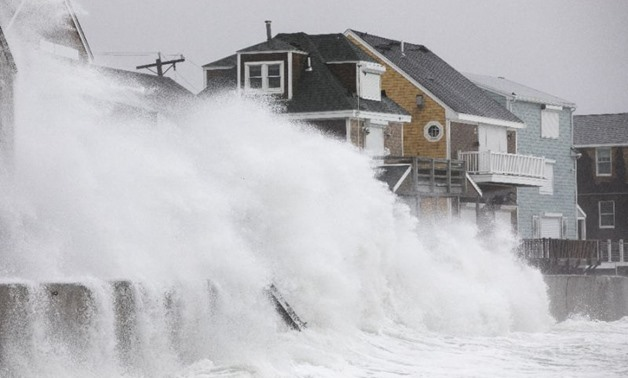 Waves crash over houses in Massachusetts as a major winter storm strikes the US east coast - AFP