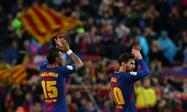 Soccer Football - La Liga Santander - FC Barcelona vs Atletico Madrid - Camp Nou, Barcelona, Spain - March 4, 2018 Barcelona's Paulinho and Lionel Messi celebrate after the match REUTERS/Albert Gea