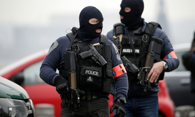 Eight people were arrested in Molenbeek, an immigrant district in the Belgian capital linked to the Paris and Brussels terror attacks - AFP