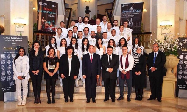"President Abdel Fatah al-SisiandMinister of Culture Inas Abdel-Dayem take a photo with the team of """"Salem Nafsak"" (Surrender) at Cairo Opera House-Official Facebook Page."