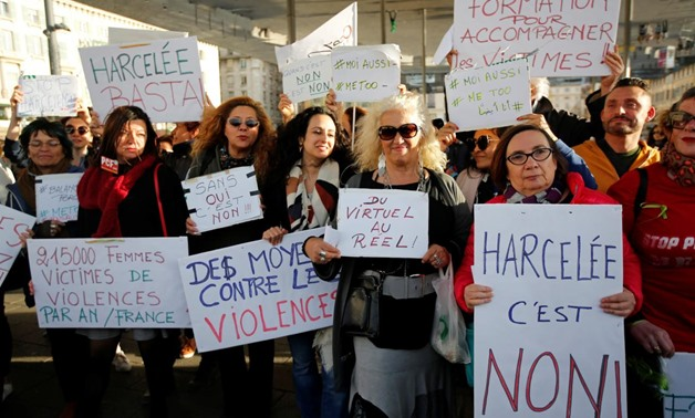 Women hold placards during a gathering against gender-based and sexual violence in Marseille, France, October 29, 2017. REUTERS/Jean-Paul Pelissier