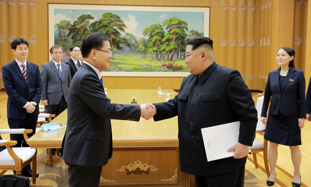 North Korean leader Kim Jong Un greets Chung Eui-yong, head of the presidential National Security Office, in Pyongyang, North Korea, March 6, 2018. The Presidential Blue House/Yonhap via REUTERS