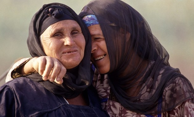 FILE – Two Egyptian women in the countryside