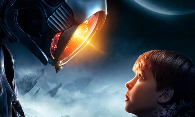 Edited image from the Lost in Space promotional poster showing Will Robinson and his robot friend, March 7, 2018 – Netflix Statement