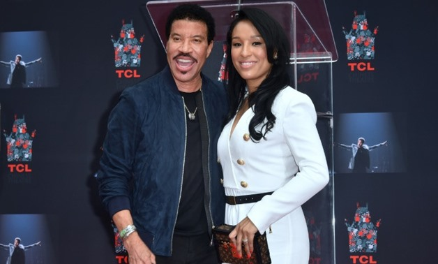 Lionel Ritchie and girlfriend Lisa Parisi at his Hand and Footprints ceremony at the TCL Theater in Hollywood, California; the 68-year-old R&B singer has sold more than 100 million records over a career spanning six decades