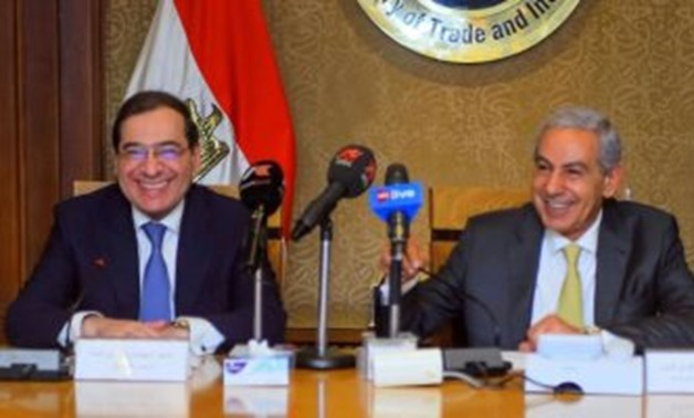 FILE - Minister of Petroleum Tarek el-Molla with Minister of Trade Tarek Kabil