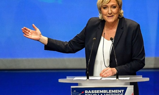 Marine Le Pen is trying to improve the French National Front's image - AFP