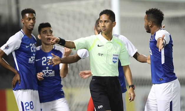 Al Hilal players argure with the referee during the game against Al Rayyan, AFC Champions League Twitter account