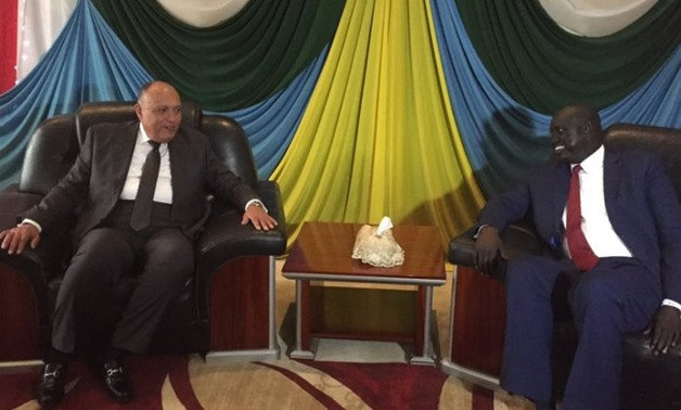 Egyptian Foreign Minister Sameh Shoukry (left) and Mayak Ding, the South Sudanese Minister of Presidential Affairs - Press photo