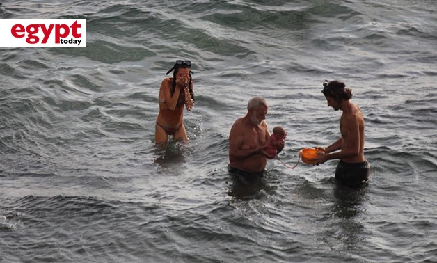 A Russian lady gave birth to a child in the Red Sea during her visit to Hurghada - photo compiled by Egypt Today