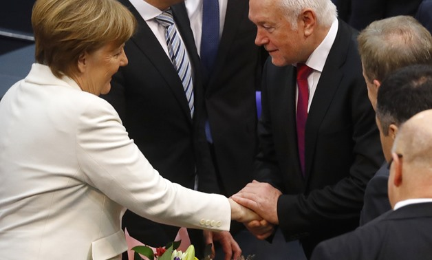 German Chancellor Angela Merkel is congratulated after being re-elected as chancellor during a session of the German lower house of parliament Bundestag in Berlin, Germany, March 14, 2018. REUTERS/Kai Pfaffenbach