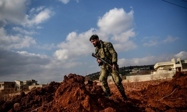 Turkish-backed Syrian rebel fighter stands guard recently on road leading to Afrin – AFP
