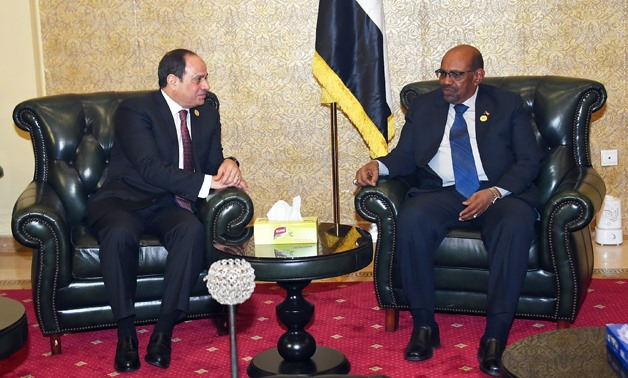 FILE-  Egyptian President Abdel Fatah al-Sisi (L) meets with Sudanese counterpart Omar al-Bashir (R) in Addis Ababa on January 27, 2018- press photo