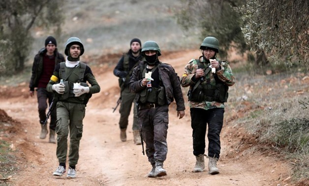 Sunday March 18, 2018. Turkish-backed Free Syrian Army fighters are seen near Mount Barsaya, northeast of Afrin