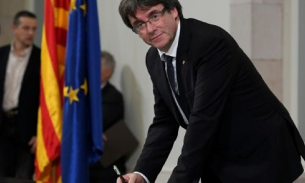 AFP/File | Carles Puigdemont signed a declaration of independence for Catalonia in October, but Spain says the gesture was illegal and irrelevant under the national constitution - AFP