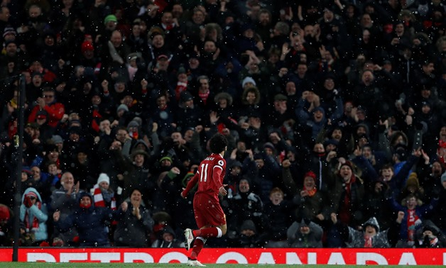Soccer Football - Premier League - Liverpool vs Watford - Anfield, Liverpool, Britain - March 17, 2018 Liverpool's Mohamed Salah celebrates scoring their fourth goal and completes his hat-trick - REUTERS/Lee Smith