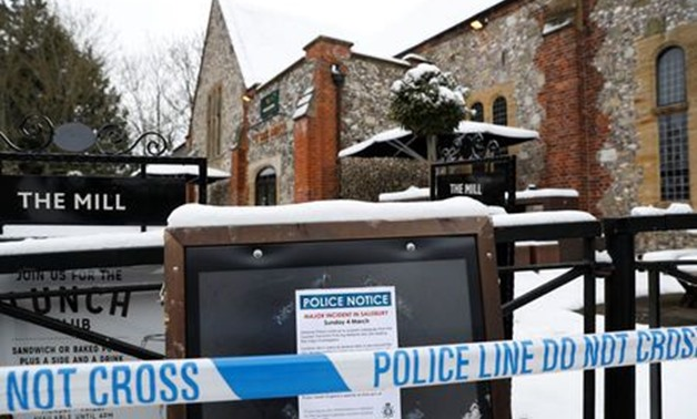 Police tape is seen in front of a pub which was visited by former Russian intelligence officer Sergei Skripal and his daughter Yulia before they were found on a park bench after being poisoned in Salisbury, Britain, March 19, 2018. REUTERS/Peter Nicholls
