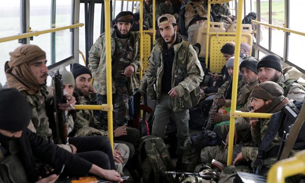 Turkish-backed Free Syrian Army fighters are on a bus in the town of al-Rai, Syria February 14, 2018. REUTERS