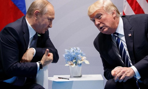 In this file photo taken on Friday, July 7, 2017, U.S. President Donald Trump, right, meets with Russian President Vladimir Putin at the G-20 Summit in Hamburg, Germany - AP Photo/Evan Vucci