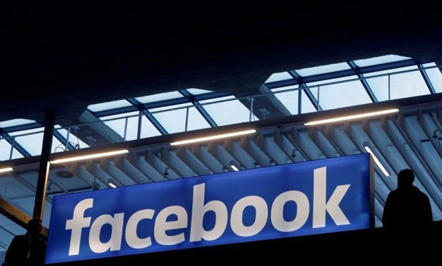 FILE PHOTO: Facebook logo is seen at a start-up companies gathering at Paris' Station F in Paris, France on January 17, 2017. REUTERS/Philippe Wojazer/File ...