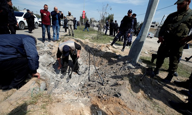 FILE PHOTO: Palestinians inspect the site of an explosion that targeted a convoy that was carrying Palestinian Prime Minister Rami Hamdallah, in the northern Gaza Strip March 13, 2018. REUTERS/Mohammed Salem/File Photo