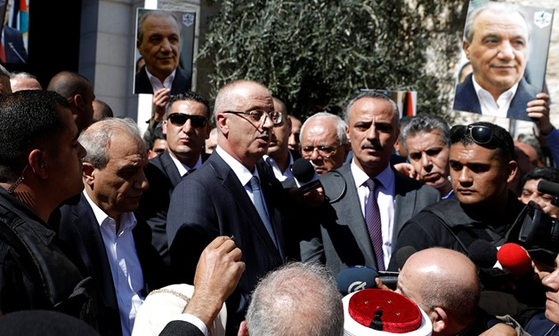Palestinian Prime Minister Rami Hamdallah speaks after he survived an assassination attempt in Gaza, at his office in the Ramallah, in the occupied West Bank March 13, 2018. REUTERS/Mohamad Torokman