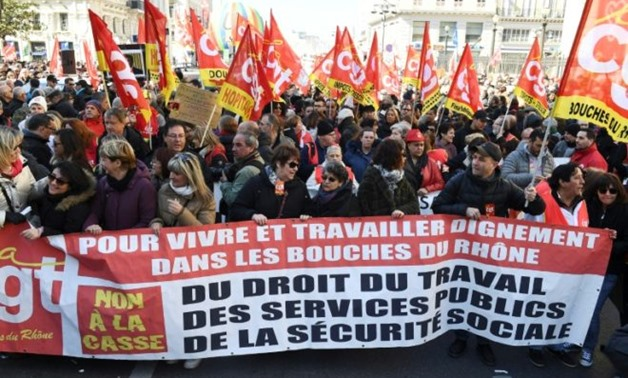 Union protesters at a demonstration in Marseille in southern France as a nationwide strike disrupts public services on Thursday - AFP